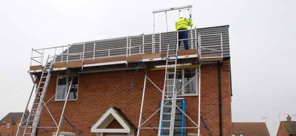 Access platform with hoist for lifting solar panels