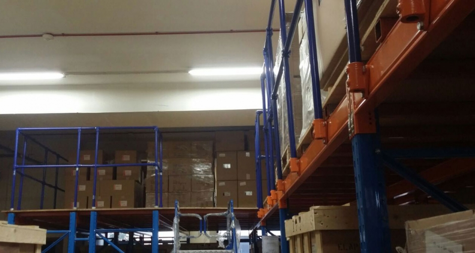 Kee Klamp guardrails provide safety for warehouse shelving