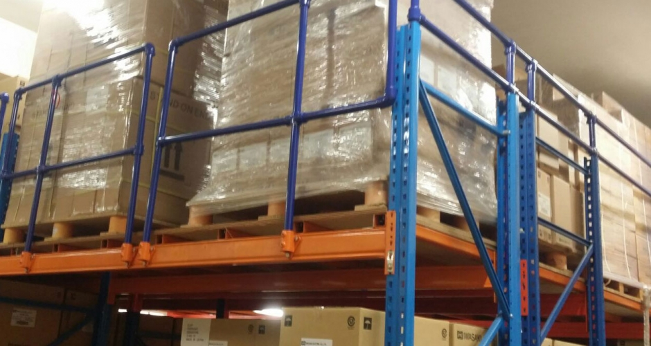 Kee Klamp guardrails provide safety for warehouse pallet racking