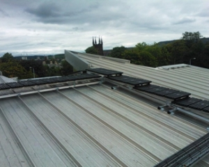 Roof top walkway to a standing seam roof