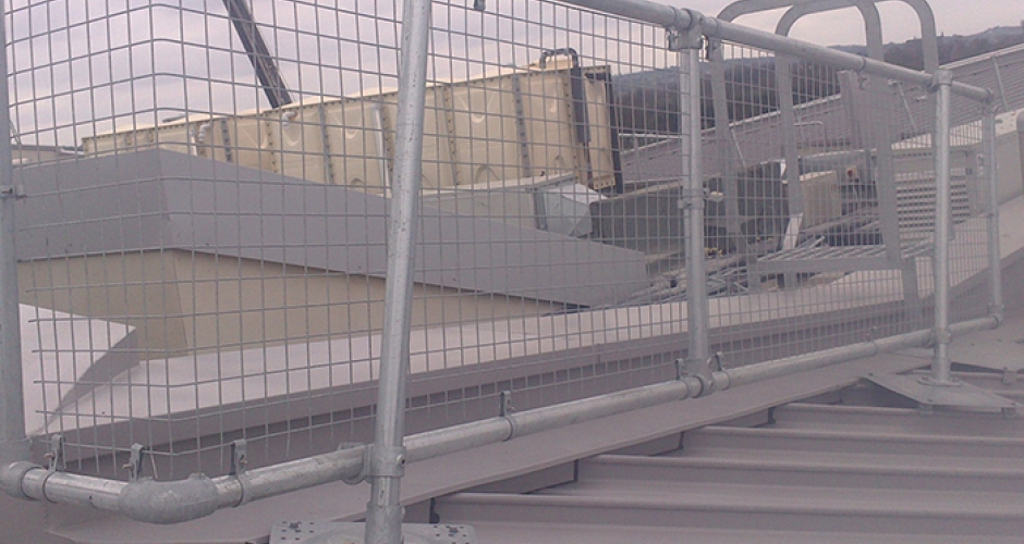 Metal Roof Guardrails With Mesh Panels On A Standing Seam