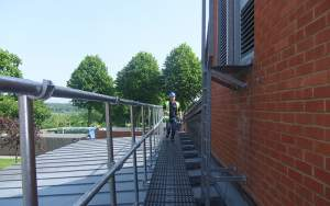 Roof walkway with guard rail