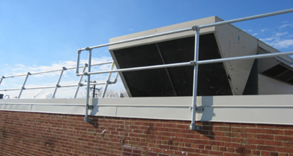 Wall mounted roof top barrier